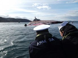 Members of the Chilean navy carry out work to check the wellboat and install an anti-pollution boom after the sinking. Photo: Chilean navy