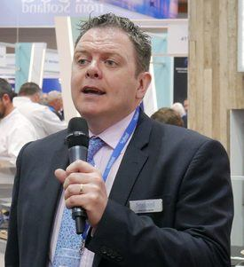 Patrick Hughes, pictured speaking at the Scottish reception at Seafood Expo Global in Brussels, has moved on. Photo: FFE.