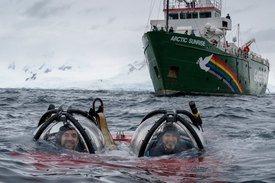 Actor Javier Bardem, left, and submarine pilot John Hocevar explore Antarctica. Photo: Greenpeace