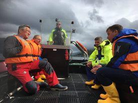 From left: Chris Ninnes, Scott Nichols, Neil MacDonald, Archie Johnstone and Ben Hadfield at Loch Lochy. Photo: Marine Harvest