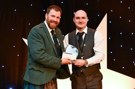 Janis Brivkalns receives his first award from host Jim Smith. Click on photo to enlarge. Photo: Lantra Scotland.