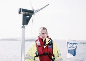 Kjetil Ørnes, sea production manager for Grieg Seafood Rogaland, at the Nordheimsøyna site in Finnøy municipality. Click on image to enlarge. Photo: Tommy Ellingsen.