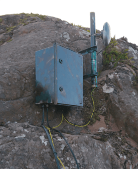 HebNet's wireless shore relay is located close to the Rum farm's feed barge. Photo: HebNet CIC.