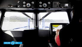 The boat's dashboard features full GMDSS communication system, radar and chart plotter. Click on image to enlarge. Photo: Hukkelberg.