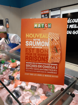 A promotional board for the algal oil-fed salmon at Supermarché Match.