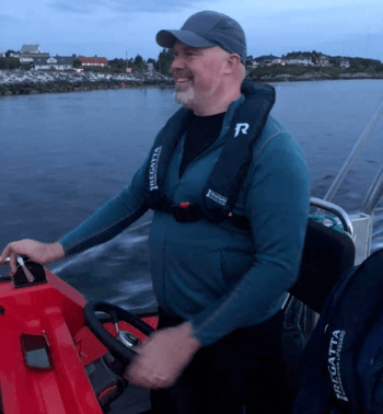 Leif AStavøstrand at the wheel of what is probably the world's fastest electric boat. Photo: Evoy AS.