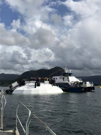 Postsmoltglobe ble døpt i dag, 20. august av Nina Grieg i Lysefjorden. Foto: FishGLOBE.
