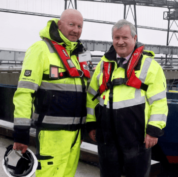 Mick Watts, Mowi's project director and global engineer, left, with local MP Ian Blackford, who officially opened the pier at the feed plant last week. Photo: Mowi.