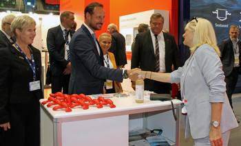 Haakon, Crown Prince of Norway shaking hands with Susan Farquharson at the Canadian booth at Aqua Nor 2019. Image: ACFFA