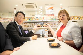 Genki CEO Takashi Houshito and Fiona Hyslop sample sushi made with SSC's Tartan Salmon. Click on image to enlarge. Photo: Scottish Government.