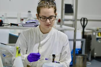 MiAlgae research assistant Anna Krzynowek at work. The company has nine staff including Douglas Martin and intends to employ five more. Photo: MiAlgae.