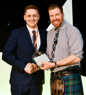 John MacPherson, left, is presented with his award by host Jim Smith. Click on image to enlarge. Photo: Lantra.