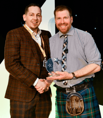 Jimmy Dakin receives his runner-up award from Jim Smith. Click on image to enlarge. Photo: Lantra.