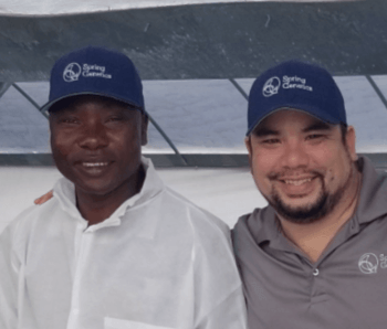 Alfred Kadzomba, left, with Hideyoshi Segovia during a visit to Spring Genetics' facility in Miami last year. Photo: Spring Genetics.