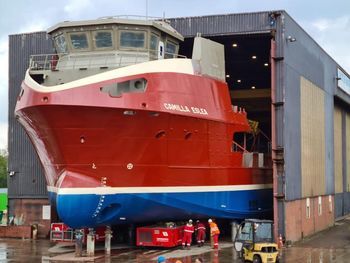 The front half of the Camilla Eslea was moved out of the shed to fit the wheelhouse. Photo: Nauplius Workboats/Inverlussa.