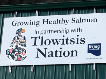 A sign displayed on a Clio Channel salmon farm that shows the partnership between the Tlowitsis Nation and Grieg Seafood. Photo: Grieg Seafood.