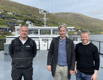 From left:  Mowi Faroe Islands technical manager Árni Hoydal Thomassen, managing director Hans Jákup Mikkelsen and site manager Jógvan Egholm, on the deck of the feed barge. Click on image to enlarge. Photo: JT electric.