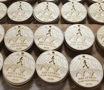 Some of the 900 medals made in the woodwork class. Click on image to enlarge. Photo: SSC.