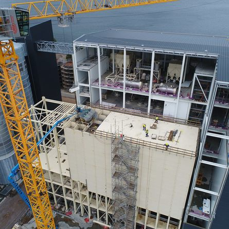 The sight of construction workers demonstrates the huge scale of the main building at Kyleakin.