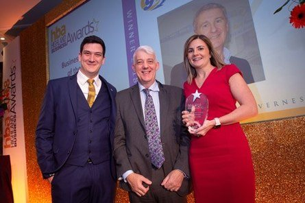 Stewart Graham's son, Craig, and daughter, Rhiann, collect his Business Leader of the Year award.