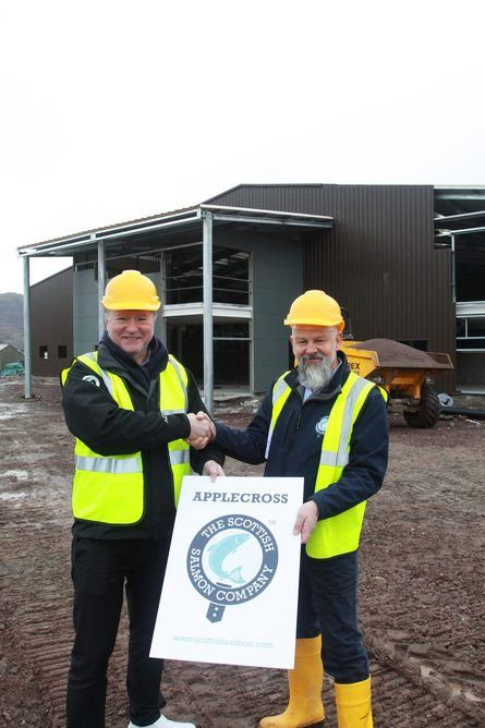 Sign here: Craig Anderson and Richard Polanski in front of the under-construction Applecross Kishorn facility. Photo: SSC.