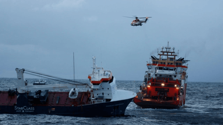 Fish farm vessels salvaged as helicopter crews get tow on stricken cargo ship