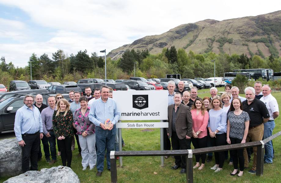 Steve Bracken, front left, and Malcolm Johnstone, front right, are joined by some of Bracken's colleagues at MH Scotland's Fort William HQ to celebrate his RSPCA recognition award. Photo: Abrightside Photography