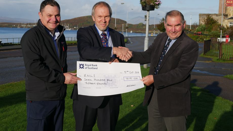 ASSG executive director Nick Lake, centre, presents a cheque to Oban lifeboat coxswain Richard Johnson, left, and lifeboat station chairman Mike Robertson. Photo: FFE