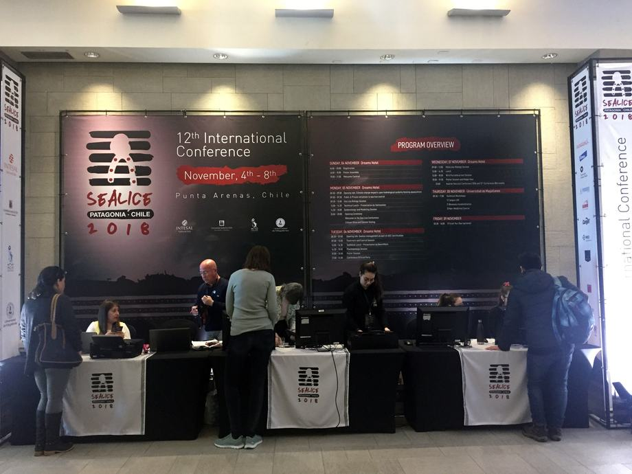 <p>Delegates check in to the conference.</p>