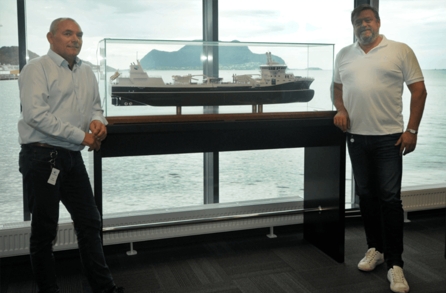 Roger Halsebakk, left, and communications manager Harald Tom Nesvik with the model of the world's largest well boat, Ronja Storm, owned by Sølvtrans and leased by Tasmanian salmon farmer Huon Aquaculture. The photo was taken in Sølvtrans' premises on Skansekaia in Ålesund. Photo: Pål Mugaas Jensen.