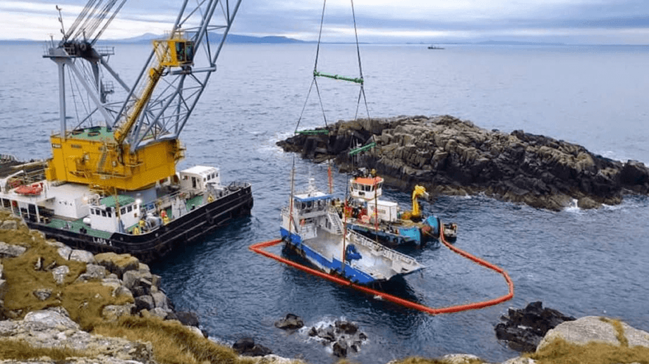 The Tiffany of Melfort being lifted on to the Lara 1 after being raised from the seabed in the Shiant Isles east of Harris. Photo: Kames.