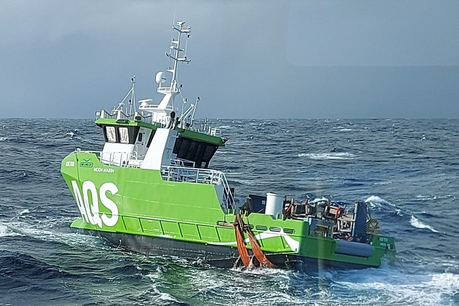 The AQS Tor is drifting south off the coast of Norway after being washed off the deck of a freighter in heavy seas. The freighter is also drifting after its crew was forced to abandon ship for their own safety. Photo taken from the Stadt Sløvåg tugboat.