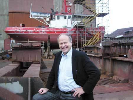 """Styreforman i Bergen Group ASA, Magnus Stangeland. I bakgrunnen prosjektet """"Ruggen IV"""""""