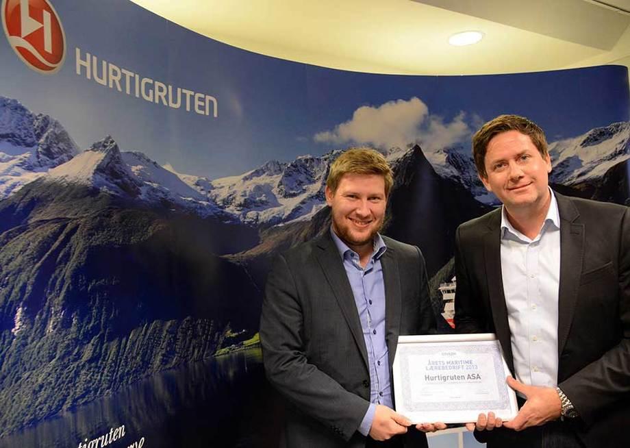 Jørn Sund-Henriksen (t.v.) Norges Rederiforbund - Daniel Skjeldam, Hurtigruten ASA. (foto: Hurtigruten ASA.)