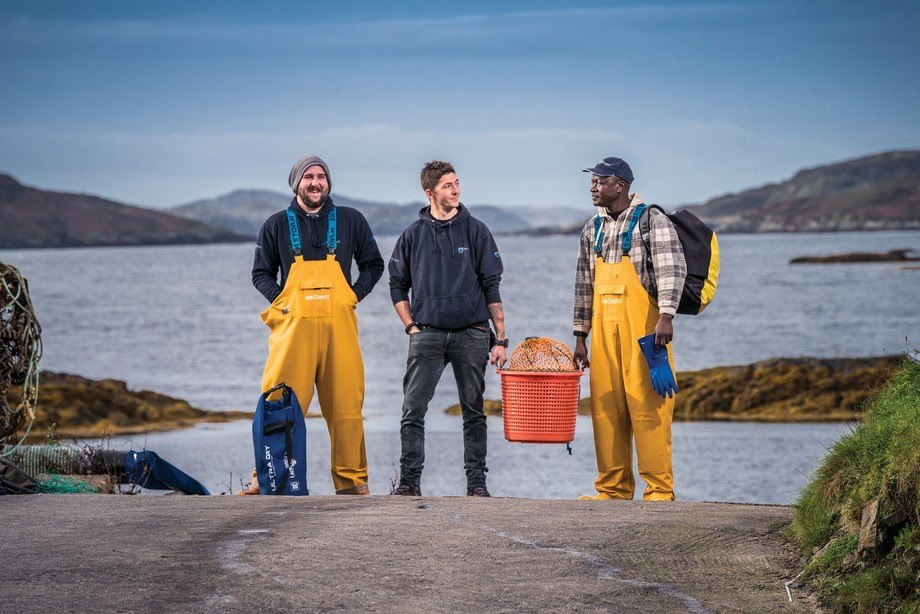 Hard grafters: From left, Duncan MacNicol, Lewis Bennett and Daniel Otieno are among 115 staff praised by boss Alban Denton. Photo: Loch Duart