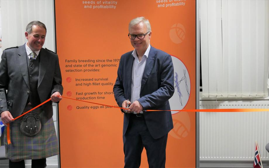 Odd Magne Rødseth cuts a ribbon to officially open AquaGen's Scottish office, as Scotland chief Andy Reeve looks on. Photo: FFE