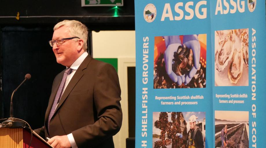 Cabinet Secretary for the Rural Economy and Connectivity Fergus Ewing speaks at the ASSG conference in Oban. Photo: Fish Farming Expert.