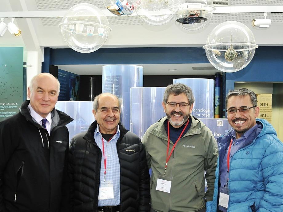 David Guthrie, left, head of enterprise at SAMS Research Services Ltd, meets representatives of Chile's Instituto de Fomento Pesquero, from left: Gabriel Yany, Leonardo Nunez and Mauricio Galvez. Photo: SAMS