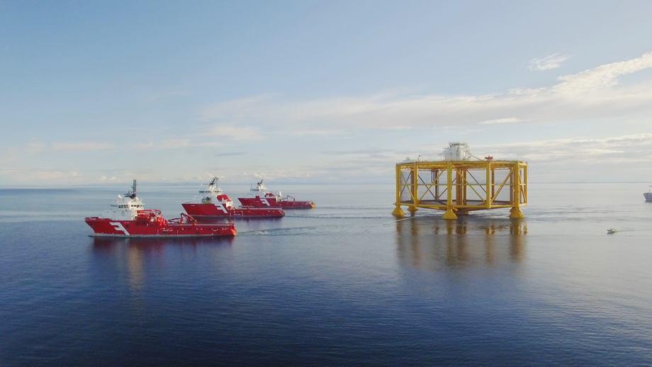 Three powerful anchoring tugs tow Salmar's Ocean Farm 1 into position. Photo: Solstad Farstad