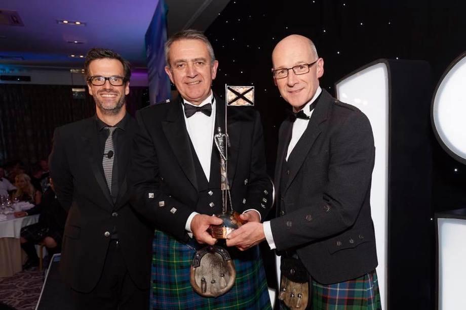MH Scotland's Steve Bracken, centre, with host Marcus Brigstock, left, and John Swinney at Friday's awards ceremony. Photo: MH Scotland