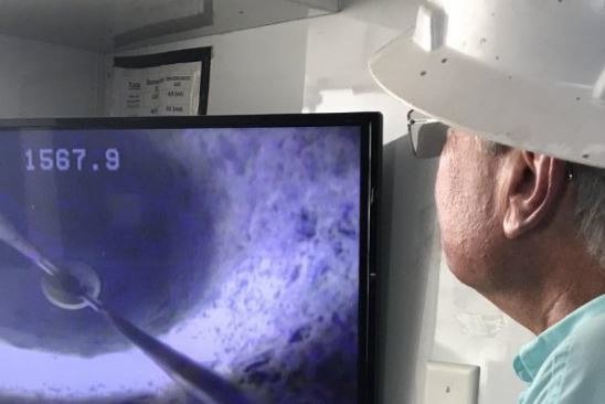 An engineer looks at a monitor image of the MF-4 well sunk to provide pure salt water to the Atlantic Sapphire farm in Miami. Photo: Atlantic Sapphire