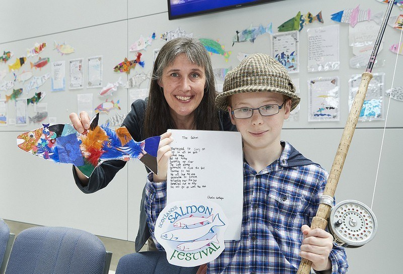 Charlie Cartlidge, a pupil from Balloch Primary School, with Dr Melanie Smith, chair of Scotland's Salmon Festival steering group and Head of Research Development at Inverness College UHI. Charlie won a competition to write a poem about salmon to promote the fesitval. Photo: UHI Inverness College
