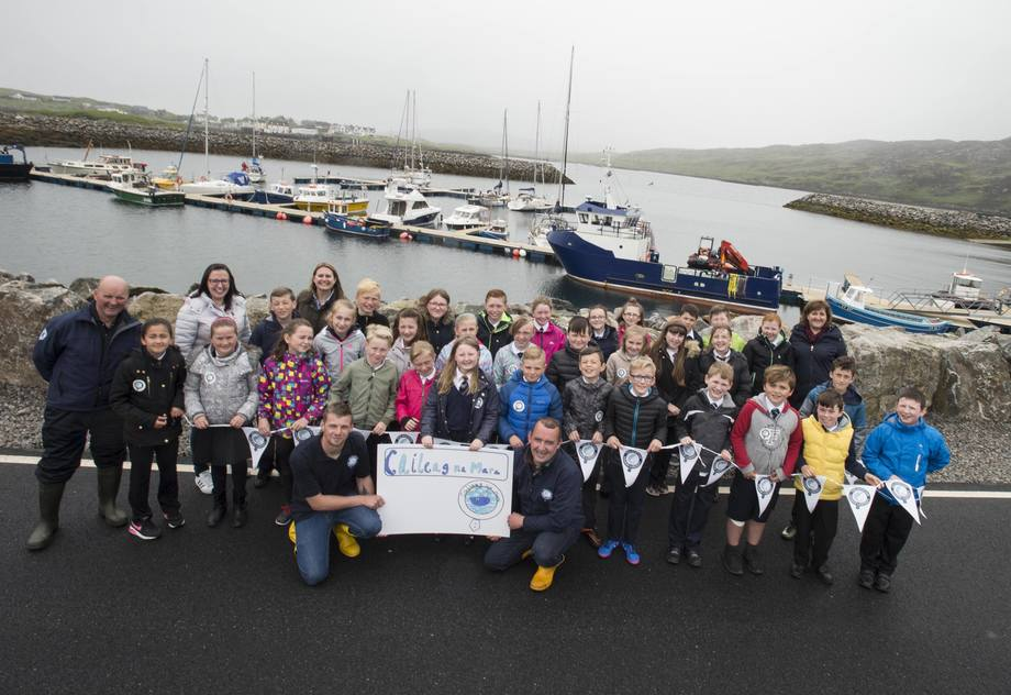 Sine Macleod from Snishival on South Uist with her schoolmates and SSC employees in front of the Caileag na Mara. Photo: Christian Cooksey/SSC.