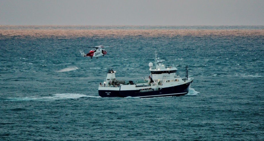 The Ronja Viking, pictured with a Coastguard helicopter during an exercise off Sumburgh Head. Photo: Ronnie Robertson/Wikimedia