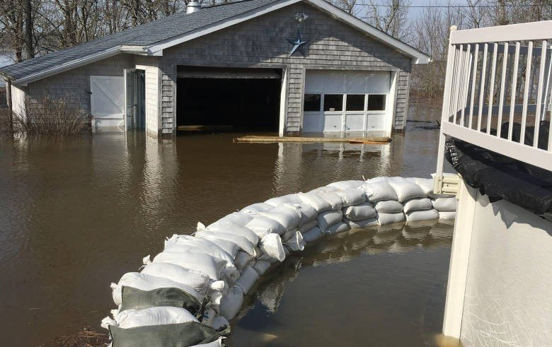 Residents have been using sandbags to try to protect their homes. Photo: CBC News