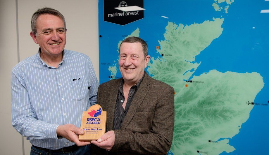 Steve Bracken, left, receives his award from RSPCA Assured aquaculture manager Malcolm Johnstone. Photo: Abrightside Photography