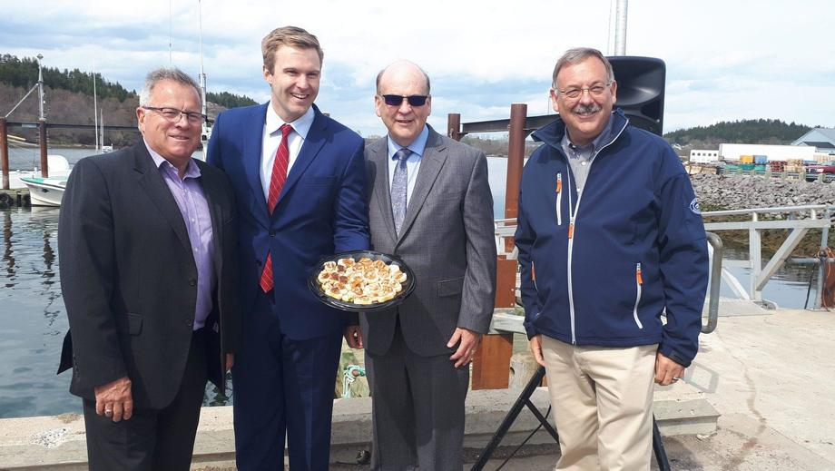 From left: Rick Doucet, NB's Aquaculture and Fisheries Minister, Premier Brian Gallant, Cooke Aquaculture CEO Glen Cooke and COO Mike Cooke. Image: Huddle.