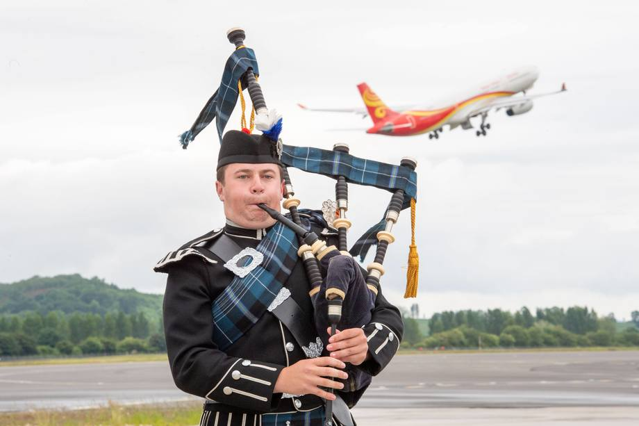 Tuesday's inaugural Hainan Airlines flight was accompanied by the sound of Scottish pipes. Today's - the first direct to Beijing - was accompanied by Scottish salmon. Photo: Ian Georgeson