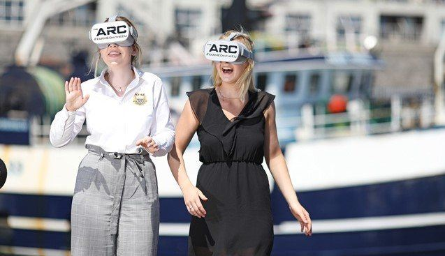 Sadhbh Hendrick and Deanna Dooley try out the ARC headsets at Seafest in Galway. Photo: BIM