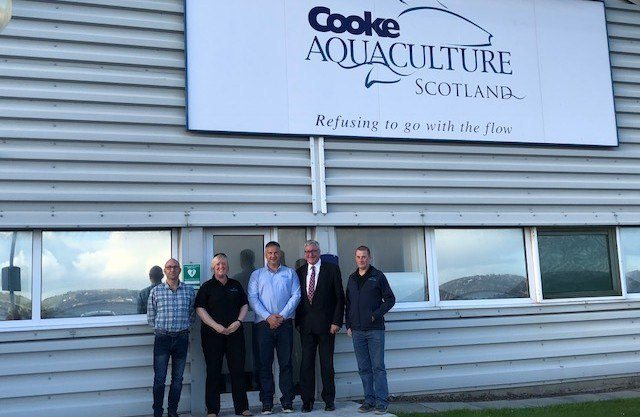 Fergus Ewing, second from right, with, from left, Cooke employees Christopher Webb, environmental and development manager; Vicci Laird, head of HR; Stewart Rendall, Westray/East Skelwick manager); Robert Peterson, Orkney area manager.